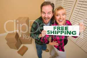 Goofy Couple Holding Free Shipping Sign Surrounded by Boxes