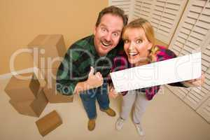 Goofy Goofy Thumbs Up Couple Holding Blank Sign Surrounded by Bo