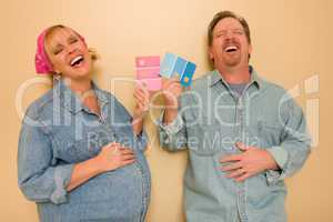Pregnant Laughing Couple Deciding on Pink of Blue Wall Paint.