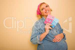 Pensive Pregnant Woman Holding Pink and Blue Paint Swatches.