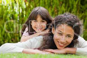 Adorable mother with her daughter in the garden