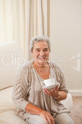 Mature woman drinking some tea