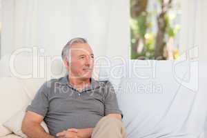 Senior sitting  in his sofa