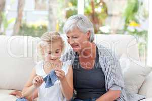 Senior knitting with her granddaughter