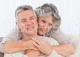 Mature woman hugging her husband