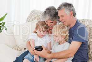 Family looking at their camera