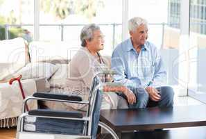 Lovely retired couple talking on the sofa