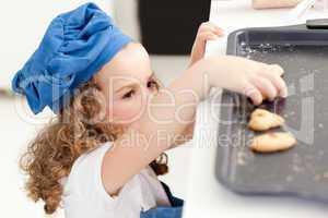 Little girl stealing cookies