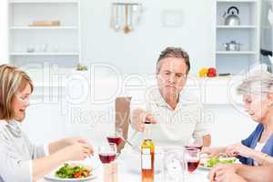 Mature friends taking lunch together
