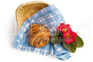 Croissant with a basket and flowers