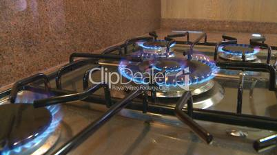 Gas stove burners flames dolly back