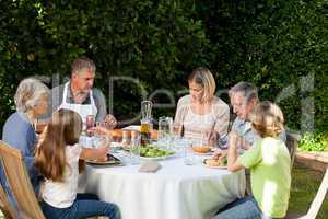 Adorable family eating in the garden