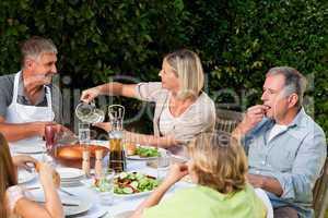 Lovely family eating in the garden