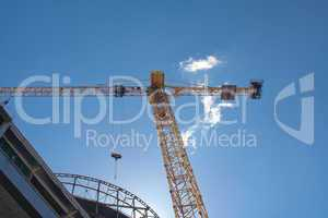 Crane and modern building in the sky and cloud