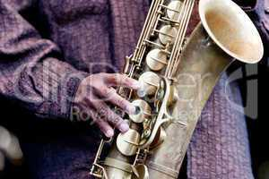 Hand and Saxophone