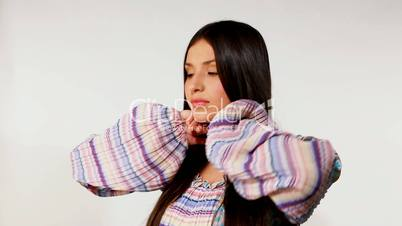 Young girl take care of long hair - russian ethnic costume