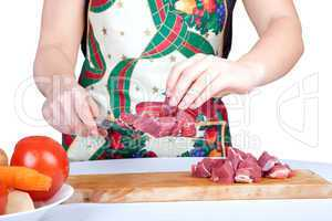 Woman cutting beef isolated on white