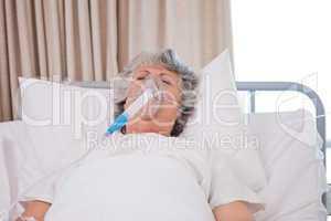 Senior woman with her respirator