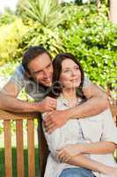 Glad couple hugging in the garden