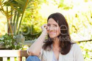 Portrait of a lovely woman in the garden