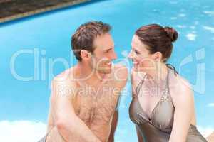 Couple beside the swimming pool