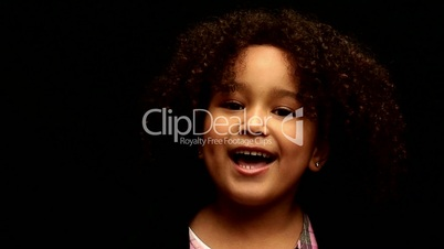 Young black girl/child with curly hair talking to camera 2