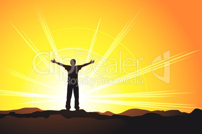 man standing on top of the hill with raised hands