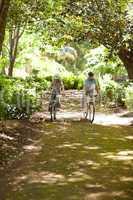 Elderly couple mountain biking outside