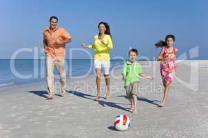 Mother, Father and Children Family Running With Football on Beac