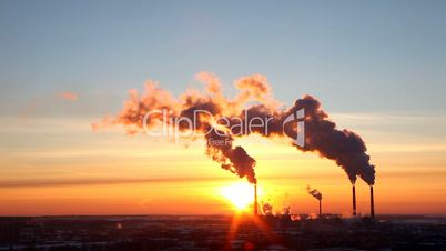 Termal power station smoke silhouette at sunset