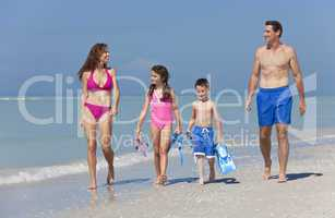 Mother, Father and Children Family Having Fun At Beach