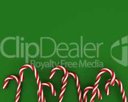 Christmas candies on green background