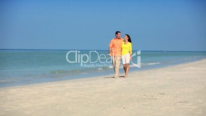 Young Couple Walking the Beach