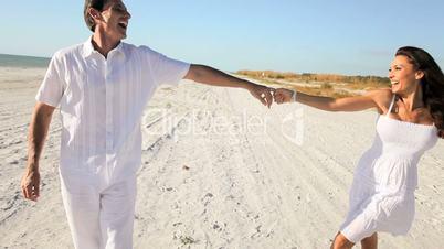 Healthy Couple Beach Fun