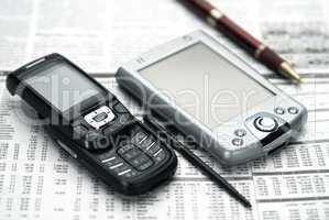 Pen, pocket, mobile on newspaper.