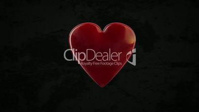 Großes rotes Herz mit schwarzen Hintergrund zerspringt