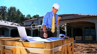 Architect on Site Using Cell Phone