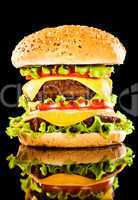 Tasty and appetizing hamburger on a dark