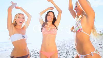 Girls Dancing on the Beach