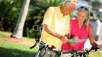 Senior Couple Mapping a Cycling trip