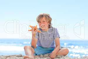 Little boy with a starfish