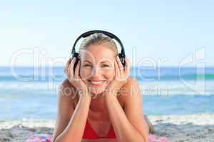 Radiant woman listening to some music