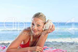 Woman listening to a shell