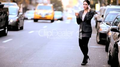 Businesswoman with Coffee & Cell Phone