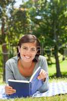 Woman reading a book in the park