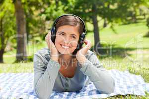 Woman listening to some music in the park