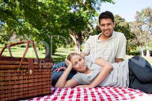Lovers picnicking in the park