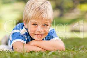 Boy lying down in the park