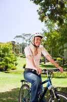Woman in the park with her bike