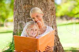Daughter and her mother looking at their album photo